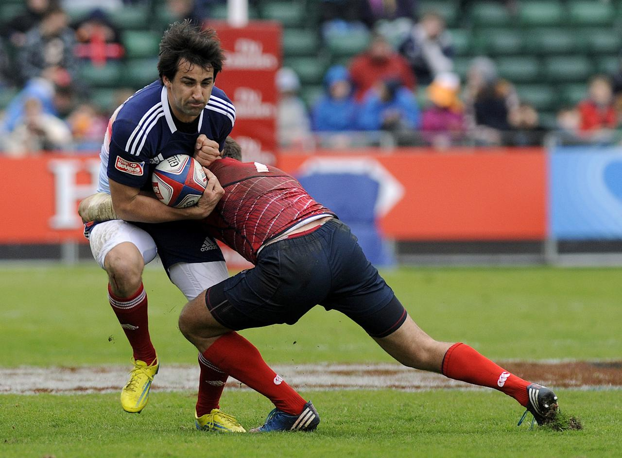 Paul Albaladejo of France is tackled by Nikolay Goroshilov (R) of Russia during their Rugby Union Glasgow Sevens game at Scotstoun Stadium in Glasgow, Scotland, on May 4, 2013. France won the game 15-14. AFP PHOTO/ANDY BUCHANANAndy Buchanan/AFP/Getty Images