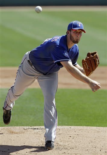 Texas Rangers' Greg Reynolds pitches against the Los Angeles Dodgers in the first inning of a spring training baseball game Friday, March 16, 2012, in Glendale, Ariz. (AP Photo/Mark Duncan)