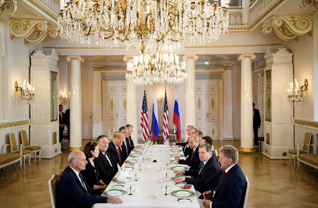 <p>U.S. President Donald Trump, Russia's President Vladimir Putin and others wait for a working lunch meeting at Finland's Presidential Palace on July 16, 2018 in Helsinki, Finland. (Photo: Brendan Smialowski / AFP) </p>