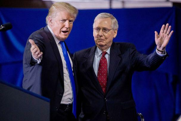 PHOTO: President Donald Trump invites Senate Majority Leader Mitch McConnell, right, onstage as he speaks at a rally at Alumni Coliseum in Richmond, Ky., Oct. 13, 2018. (Andrew Harnik/AP)