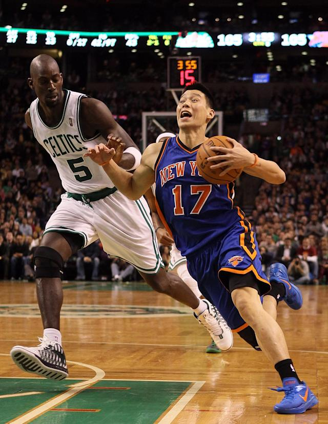 BOSTON, MA - MARCH 04: Jeremy Lin #17 of the New York Knicks drives around Kevin Garnett #5 of the Boston Celtics on March 4, 2012 at TD Garden in Boston, Massachusetts. The Boston Celtics defeated the New York Knicks 115-111 in overtime. NOTE TO USER: User expressly acknowledges and agrees that, by downloading and or using this photograph, User is consenting to the terms and conditions of the Getty Images License Agreement. (Photo by Elsa/Getty Images)