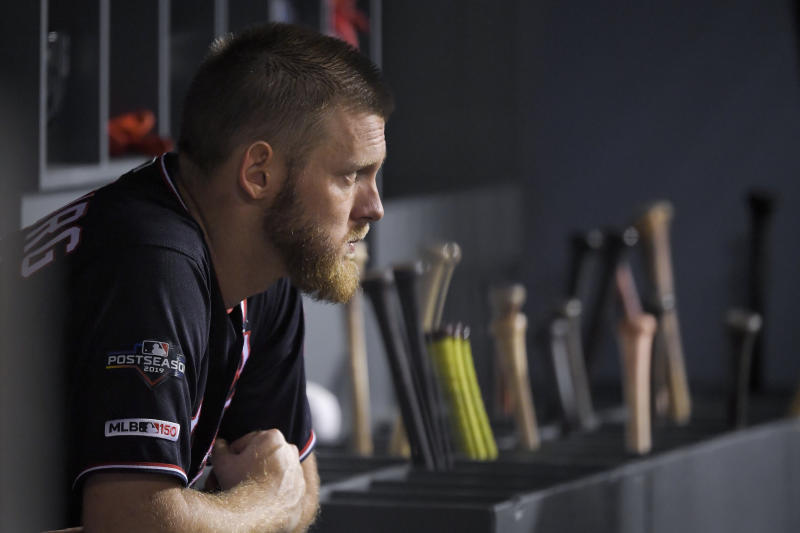 Washington Nationals starting pitcher Stephen Strasburg watches from the dugout during the seventh inning in Game 2 of the baseball team's National League Division Series against the Los Angeles Dodgers on Friday, Oct. 4, 2019, in Los Angeles. (AP Photo/Mark J. Terrill)