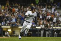 Milwaukee Brewers' Ben Gamel hits a walk-off single during the ninth inning of a baseball game against the San Francisco Giants Saturday, July 13, 2019, in Milwaukee. The Brewers won 5-4. (AP Photo/Morry Gash)
