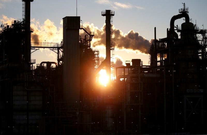 Smoke rises from a factory during the sunset at Keihin industrial zone in Kawasaki