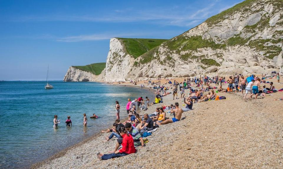 Summer on Durdle Door beach in Dorset. Many British holidaymakers who booked a domestic break this summer will not have considered insurance for a UK trip.