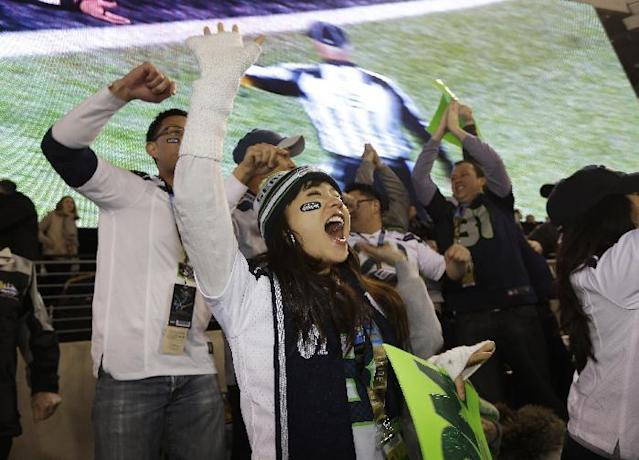 A Seattle Seahawks fan celebrates as the Seahawks come up with a safety against the Denver Broncos the NFL Super Bowl XLVIII football game Sunday, Feb. 2, 2014, in East Rutherford, N.J. (AP Photo/Seth Wenig)
