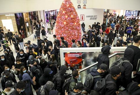 Anti-government protesters hold a 'Christmas shopping rally' at the Harbour City shopping mall in Tsim Sha Tsui. Winson Wong