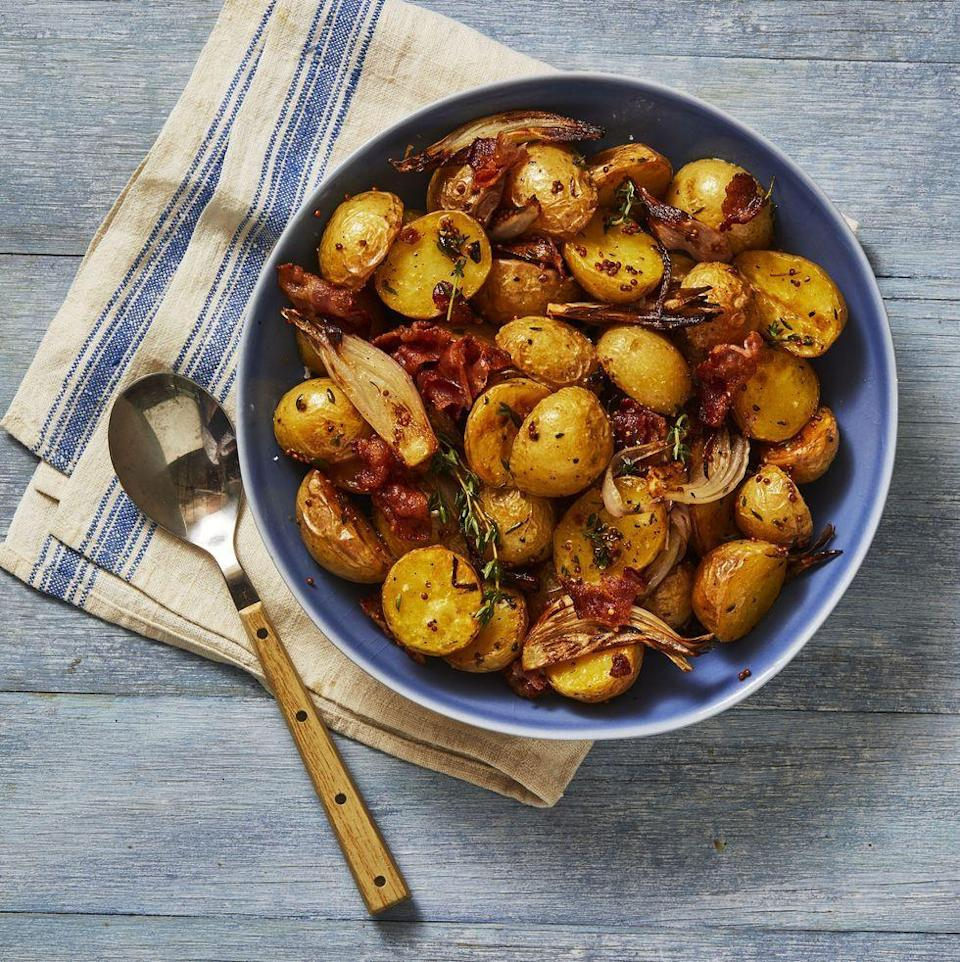 """<p>Creamy potatoes mixed with crispy bacon makes a great side for just about any protein. </p><p><em><a href=""""https://www.goodhousekeeping.com/food-recipes/a34221356/bacon-roasted-potatoes-recipe/"""" rel=""""nofollow noopener"""" target=""""_blank"""" data-ylk=""""slk:Get the recipe for Bacon-Roasted Potatoes »"""" class=""""link rapid-noclick-resp"""">Get the recipe for Bacon-Roasted Potatoes »</a></em></p>"""
