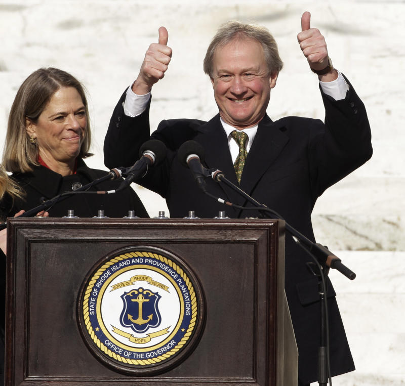 Gov. Lincoln Chafee, a former Republican U.S. senator, gestures after taking the oath of office as Rhode Island's first independent governor on the steps of the Statehouse in Providence, R.I., Tuesday afternoon, Jan. 4, 2011 as his wife Stephanie looks on.  (AP Photo/Stephan Savoia)