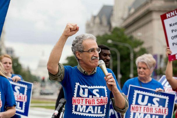 PHOTO: American Postal Workers Union president Mark Dimondstein pumps his fist while speaking at a rally at Freedom Plaza, Washington, Oct. 8, 2018 (Andrew Harnik/AP, FILE)