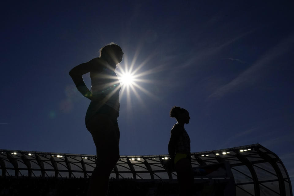 Competitors stand for the national anthem before the prelims of the women's pole vault the U.S. Olympic Track and Field Trials Thursday, June 24, 2021, in Eugene, Ore. (AP Photo/Charlie Riedel)tonal at the