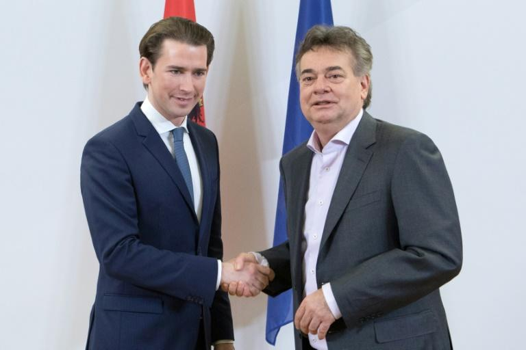 Austria's conservatives led by Sebastian Kurz (L) Greens leader Werner Kogler on Wednesday agreed to form an unprecedented coalition government