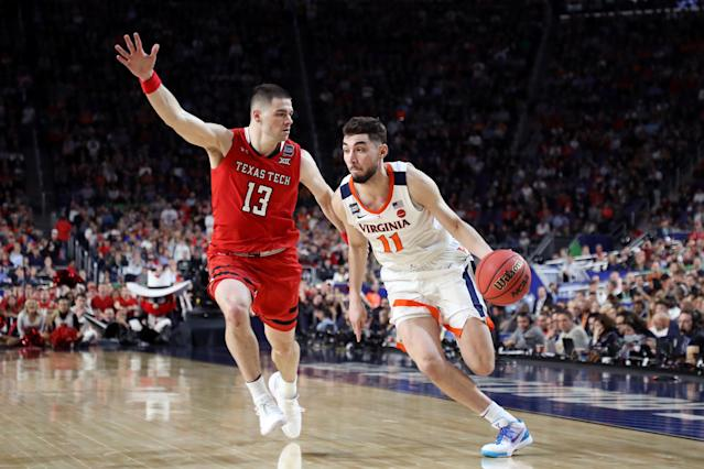 Ty Jerome #11 of the Virginia Cavaliers is defended by Matt Mooney #13 of the Texas Tech Red Raiders in the second half during the 2019 NCAA men's Final Four National Championship game at U.S. Bank Stadium on April 08, 2019 in Minneapolis, Minnesota. (Photo by Streeter Lecka/Getty Images)