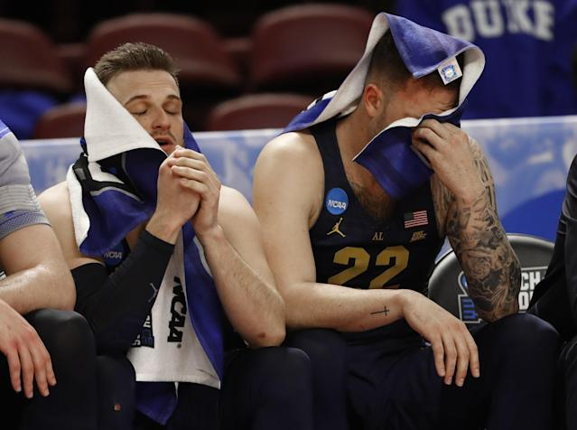 <p>Marquette's Andrew Rowsey, left, and Katin Reinhardt, right, sit on the bench in the final minutes during the second half in a first-round game against South Carolina in the NCAA men's college basketball tournament in Greenville, S.C., Friday, March 17, 2017. (AP Photo/Chuck Burton) </p>