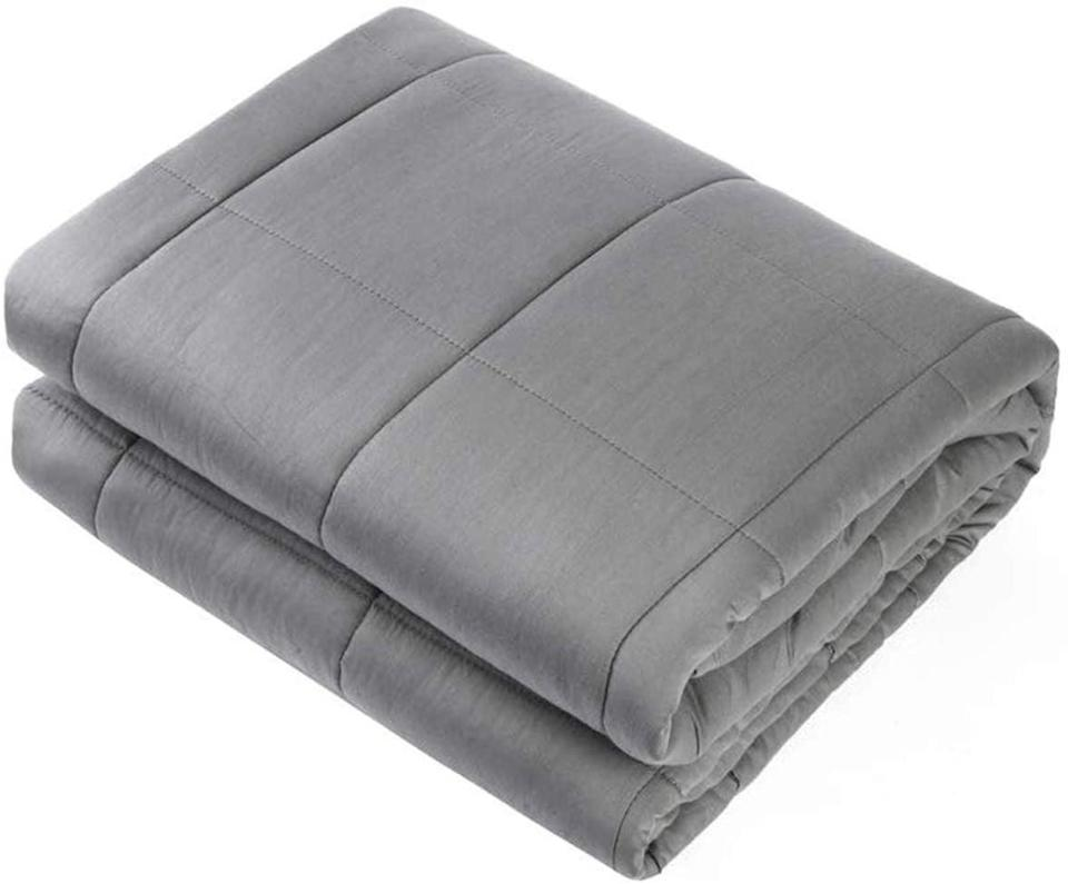 """<p>Stay on the couch with this <a href=""""https://www.popsugar.com/buy/Waowoo-Adult-Weighted-Blanket-Queen-Size-557393?p_name=Waowoo%20Adult%20Weighted%20Blanket%20Queen%20Size&retailer=amazon.com&pid=557393&price=40&evar1=fit%3Aus&evar9=47315539&evar98=https%3A%2F%2Fwww.popsugar.com%2Ffitness%2Fphoto-gallery%2F47315539%2Fimage%2F47315540%2FWaowoo-Adult-Weighted-Blanket-Queen-Size&list1=shopping%2Camazon%2Cstress%20relief%2Canxiety%2Chealthy%20living&prop13=mobile&pdata=1"""" class=""""link rapid-noclick-resp"""" rel=""""nofollow noopener"""" target=""""_blank"""" data-ylk=""""slk:Waowoo Adult Weighted Blanket Queen Size"""">Waowoo Adult Weighted Blanket Queen Size</a> ($40, originally $60).</p>"""