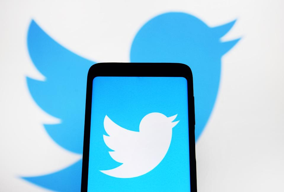 UKRAINE - 2021/01/11: In this photo illustration a Twitter logo is seen displayed on a smartphone and a computer screen in the background. (Photo Illustration by Pavlo Gonchar/SOPA Images/LightRocket via Getty Images)