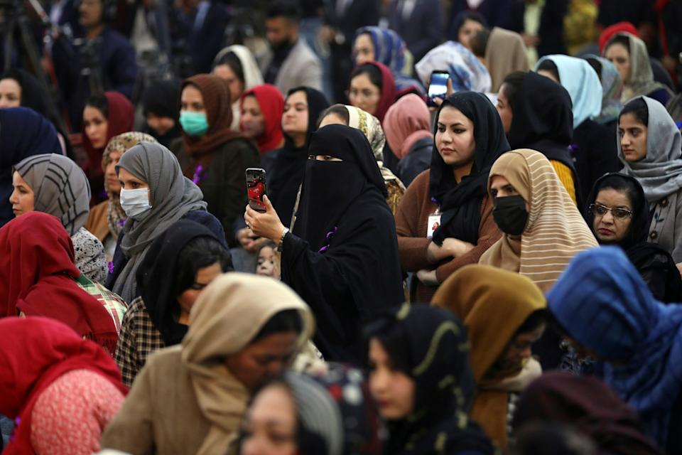 Afghan women attend an event to mark International Women's Day in Kabul, Afghanistan, March 7, 2021. Kabul's young working women say they fear their dreams may be short-lived if the Taliban come to Kabul, even as part of a government and impose their notoriously harsh brand of rule that most often took aim at girls and women.