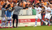 Montreal Impact's Saphir Taider (8) celebrates with teammates after scoring a goal against the Houston Dynamo during the first half of an MLS soccer match Saturday, March 9, 2019, in Houston. (AP Photo/David J. Phillip)