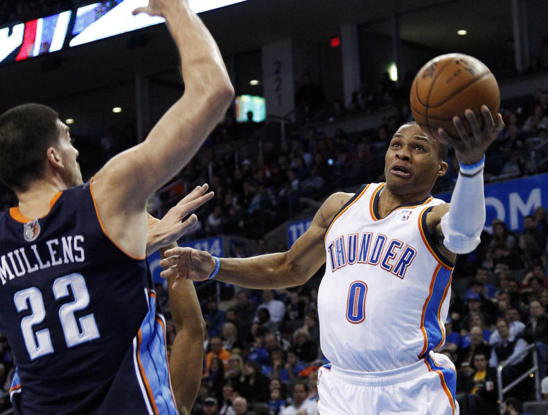 Oklahoma City Thunder guard Russell Westbrook (0) shoots as Charlotte Bobcats' Byron Mullens (22) defends in the second quarter of an NBA basketball game in Oklahoma City, Monday, Nov. 26, 2012. (AP Photo/Sue Ogrocki)