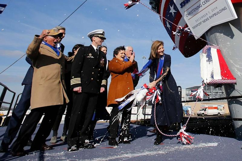 Caroline Kennedy officially christens a U.S. aircraft carrier named in honor of her father, former President John F. Kennedy. | Steve Helber/AP/Shutterstock