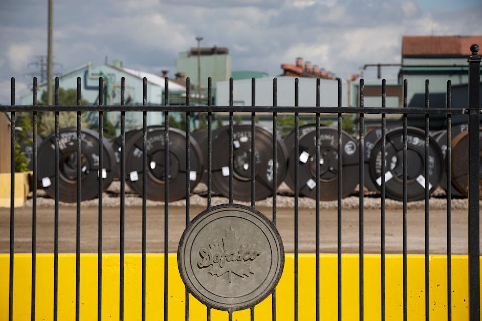 Steel coils are lined up behind the fence at the ArcelorMittal Dofasco steel plant on June 4, 2018 in Hamilton Ont. (Photo: Cole Burston via Getty Images)