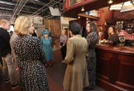 Britain's Queen Elizabeth II meets actors and members of the production team during a visit to the set of the long running television series Coronation Street, in Manchester, England, Thursday July 8, 2021. (AP Photo/Scott Heppell)