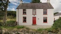"<p>Sitting on the coast of Antrim Coast & Glens Area of Outstanding Natural Beauty, this Christmas cottage comes with dramatic views. Step inside the festive red front door and you'll discover a quirky layout downstairs, which includes a spacious living room with woodburner, separate dining room and modern kitchen – everything you need for a social family Christmas.</p><p><strong>Be sure to... </strong>Take a relaxing stroll on the sandy beach that curves right past the Christmas cottage. With its secluded setting just north of the village of Cushendun, it's ideal for a Christmas coastal escape with sea views from your bedroom. </p><p><strong>Sleeps:</strong> 5</p><p><strong>Pets:</strong> No</p><p><strong>Price: </strong>£849 for 7 nights over Christmas and New Year (short breaks can be booked one month before for peak periods)</p><p><a class=""link rapid-noclick-resp"" href=""https://go.redirectingat.com?id=127X1599956&url=https%3A%2F%2Fwww.nationaltrust.org.uk%2Fholidays%2Fstrand-house-northern-ireland&sref=https%3A%2F%2Fwww.countryliving.com%2Fuk%2Ftravel-ideas%2Fstaycation-uk%2Fg33888029%2Fchristmas-cottage%2F"" rel=""nofollow noopener"" target=""_blank"" data-ylk=""slk:FIND OUT MORE"">FIND OUT MORE</a></p>"