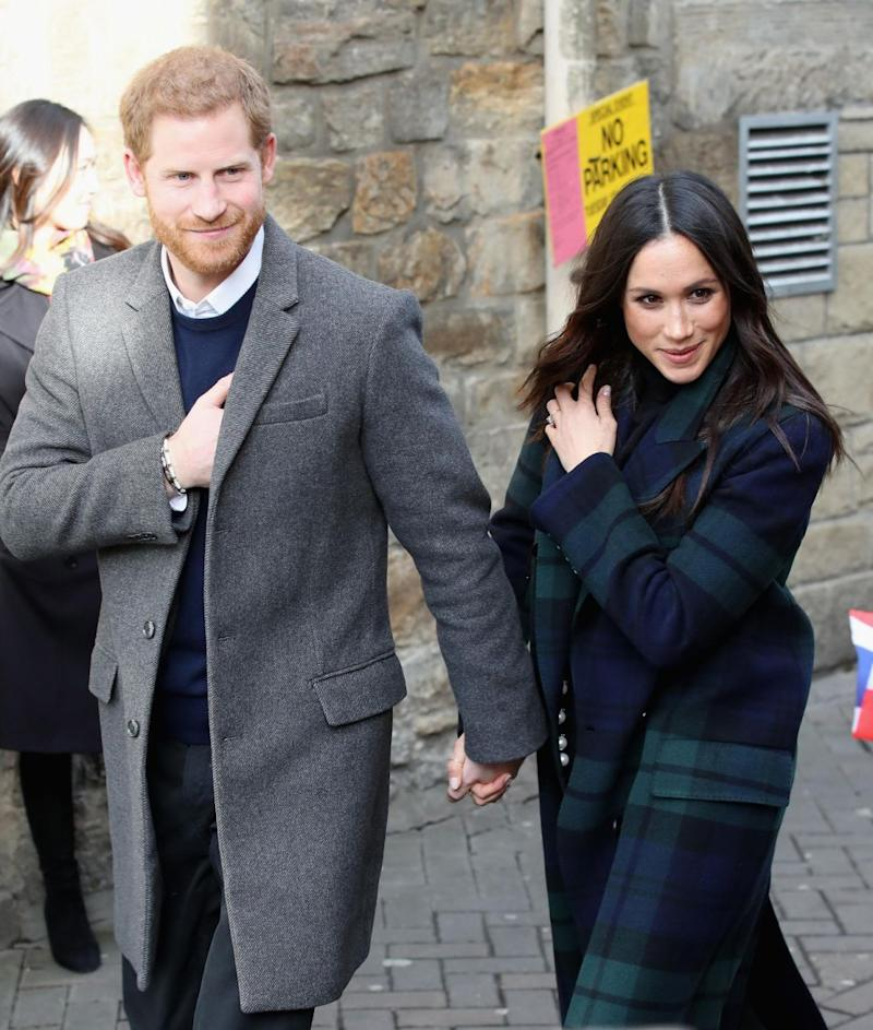 Harry and Meghan are always holding hands or walking arm in arm. Photo: Getty