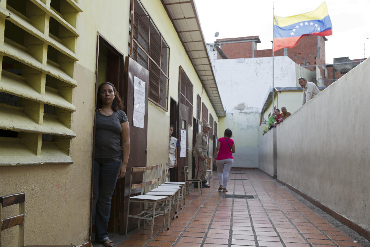 <p>An electoral official stands at her voting post at a school during the presidential election in Caracas, Venezuela, Sunday, May 20, 2018. Amidst hyperinflation and shortages of food and medicine, Venezuelan President Nicolas Maduro is seeking a second, six-year term in an election that a growing chorus of foreign governments refuse to recognize after key opponents were barred from running. (AP Photo/Ricardo Mazalan) </p>