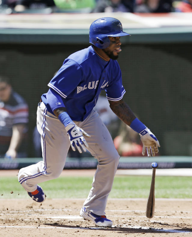Toronto Blue Jays' Jose Reyes watches his RBI single off Cleveland Indians starting pitcher Corey Kluber in the second inning of a baseball game, Saturday, April 19, 2014, in Cleveland. Brett Lawrie scored. (AP Photo/Tony Dejak)