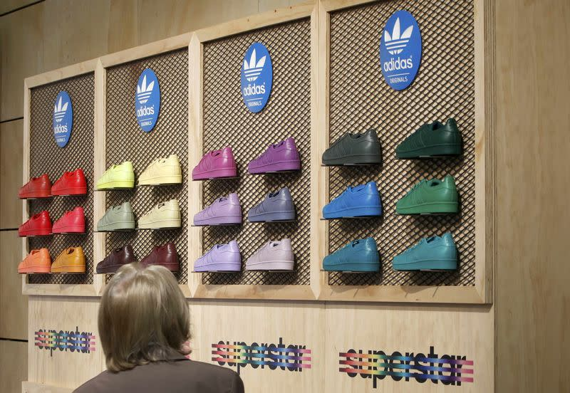 A shareholder of Adidas, the world's second largest sports apparel firm, looks at shoes during the company annual general meeting in the northern Bavarian town of Fuerth