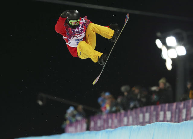 China's Cai Xuetong competes during the women's snowboard halfpipe final at the Rosa Khutor Extreme Park, at the 2014 Winter Olympics, Wednesday, Feb. 12, 2014, in Krasnaya Polyana, Russia. (AP Photo/Sergei Grits)