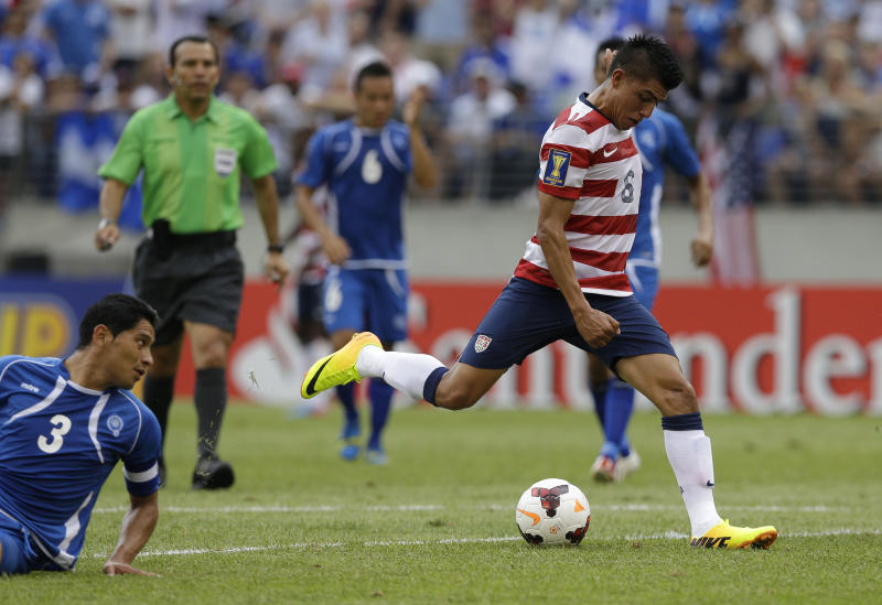 United States' Joe Corona, right, scores a goal as El Salvador's Victor Turcios Pacheco looks on during the first half in the quarterfinals of the CONCACAF Gold Cup soccer tournament on Sunday, July 21, 2013, in Baltimore. (AP Photo/Patrick Semansky)