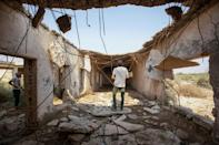 Memories of the war run deep and the ruins of buildings remain -- such as this in Iraq's al-Faw region -- but leaders in the two countries now have close ties