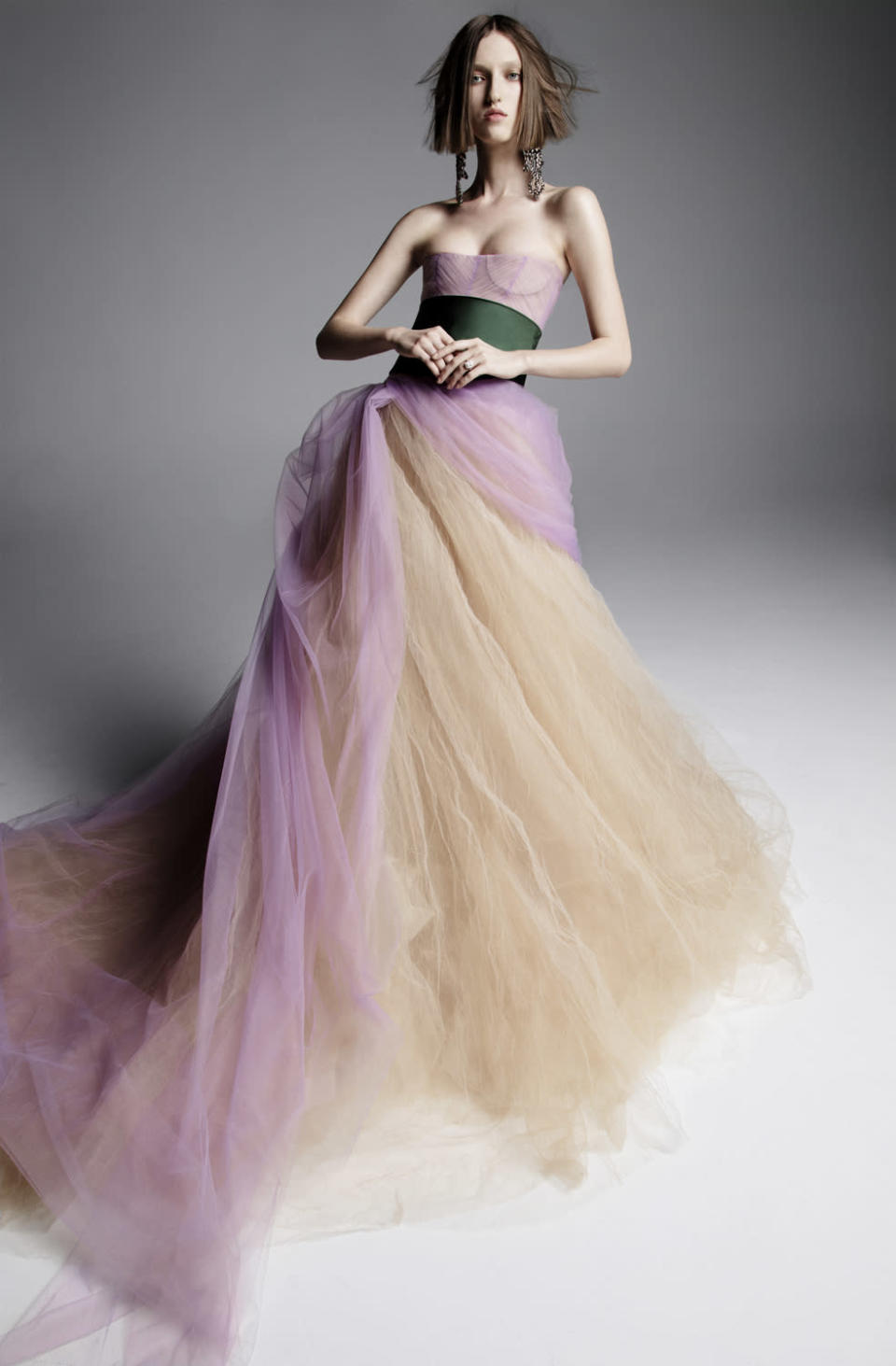 <p>Pastel purple and beige gown with green sash. (Photo: Inez & Vinoodh) </p>