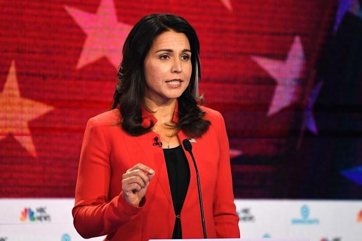 "Rep. Tulsi Gabbard of Hawaii, shown on the debate stage in Miami in June, failed to gain traction in her campaign for the Democratic presidential nomination. <span class=""copyright"">(Jim Watson / AFP/Getty Images)</span>"