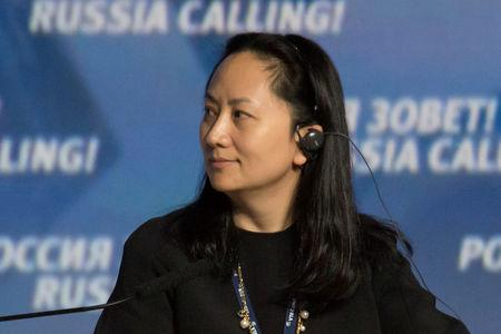 """FILE PHOTO: Meng Wanzhou, Executive Board Director of the Chinese technology giant Huawei, attends a session of the VTB Capital Investment Forum """"Russia Calling!"""" in Moscow, Russia October 2, 2014. REUTERS/Alexander Bibik/File Photo/File Photo"""