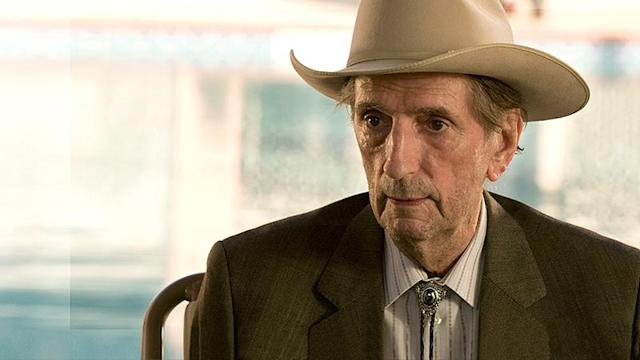"""<p>In the acclaimed HBO series, Stanton played Roman Grant, patriarch and """"prophet"""" of a polygamist community, who ends up getting smothered to death as payback for his nefarious, perverted scheming.<br><br>(Photo: HBO) </p>"""