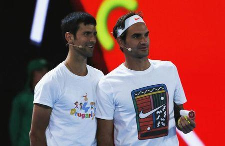 Switzerland's Roger Federer and Serbia's Novak Djokovic react during a promotional event ahead of the Australian Open tennis tournament in Melbourne
