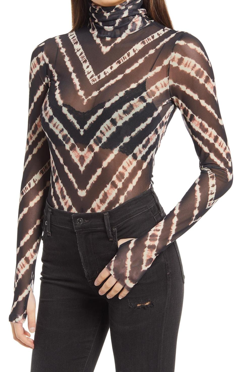 <p>If you like bold patterns, you might want to scoop up this <span>Afrm Zadie Semi Sheer Turtleneck</span> ($38).</p>