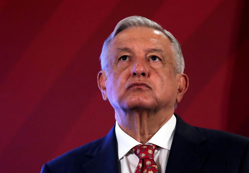 FILE PHOTO: Mexico's President Andres Manuel Lopez Obrador looks up during a news conference at the National Palace in Mexico City