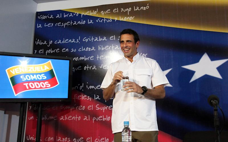 Venezuela's opposition leader Henrique Capriles arrives for a news conference at his office in Caracas, Venezuela, Wednesday, April 24, 2013. Capriles urged Venezuela's electoral commission to begin the audit of the April 14, 2013 disputed presidential vote, that handed Capriles's rival, Nicolas Maduro, a razor-thin victory. (AP Photo/Fernando Llano)