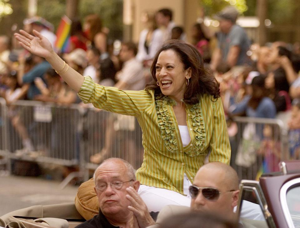 Kamala Harris, top, then San Francisco District Attorney, waves to the crowd during the annual Gay Pride Parade along Market Street in 2009.  (Photo: MediaNews Group via Getty Images)