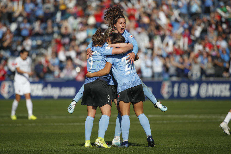 Chicago Red Stars forward Sam Kerr (20) celebrates with teammates after scoring against the Portland Thorns FC during the first half of an NWSL playoffs semi-final soccer match Sunday, Oct. 20, 2019, in Bridgeview, Ill. (AP Photo/Kamil Krzaczynski)