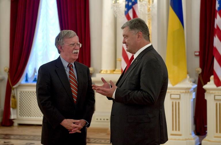 This handout photograph released by the Ukrainian presidency shows President Petro Poroshenko (R) speaking with US National Security Advisor John Bolton (L) who is visitng Kiev