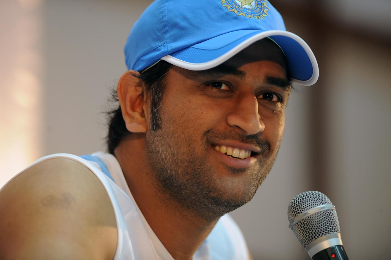 Indian cricket captain Mahender Singh Dhoni speaks during a press conference at Rajiv Gandhi International Stadium in Hyderabad on October 13, 2011. England will look to improve on their dismal one-day record in India when they clash with the injury-ravaged world champions in a five-match series starting October 14. AFP PHOTO/Noah SEELAM (Photo credit should read NOAH SEELAM/AFP/Getty Images)