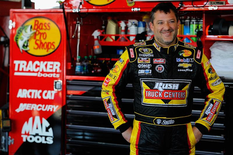 Tony Stewart looks on in the garage area during practice for a race on August 8, 2014 in Watkins Glen, New York