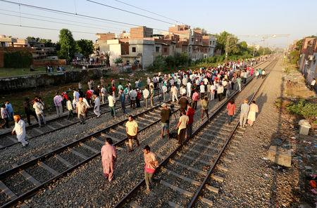 People gather at the site of an accident after a commuter train traveling at high speed ran through a crowd of people on the rail tracks on Friday, in Amritsar, India, October 20, 2018. REUTERS/Adnan Abidi