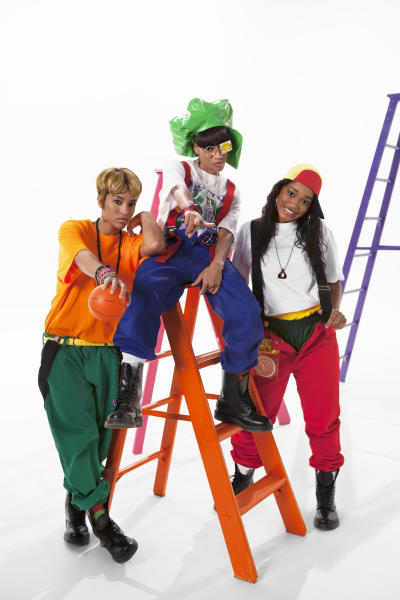 """In this undated photo provided by VH1, from left, Drew Sidora, Lil Mama and Keke Palmer play the characters of Tionne """"T-Boz"""" Watkins, Lisa """"Left Eye"""" Lopes and Rozanda """"Chilli"""" Thomas in the TLC biopic, """"CrazySexyCool: The TLC Story,"""" which premieres on Monday, Oct. 21, 2013, on VH1. (AP Photo/VH1, Blake Tyers)"""