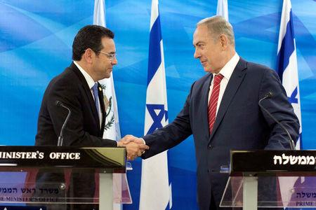 FILE PHOTO: Guatemalan President Jimmy Morales and Israeli Prime Minister Benjamin Netanyahu shake hands as they deliver statements to the media during their meeting in Jerusalem November 29, 2016. REUTERS/Abir Sultan/File Photo